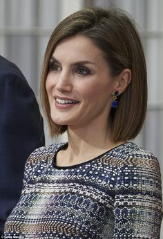 Seen at the El Pardo Palace in Madrid, Spain, Queen Letizia looked lovely in a tweed round-neck, three-quarter-length sleeved dress in shades of blue, brown and cream