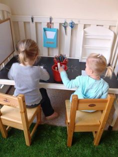 Turn an old crib into a work bench for your little ones!
