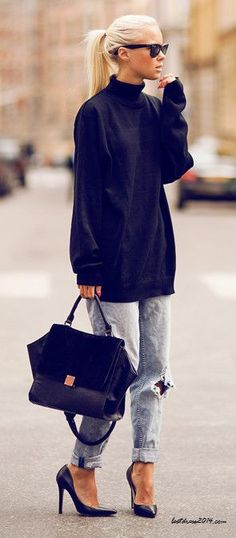 black turtleneck + jeans + black shoulder bag + black pumps + hair pulled back