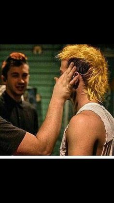 Yellow hair. Just so everyone knows this picture photoshopped and not real, but it is rumoured that he did actually dye his hair. Guess we'll just have to wait to find out!