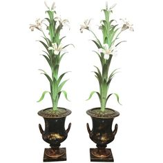Pair of Italian Tole Mantle Urns with Tole Lilies | From a unique collection of antique and modern vases and vessels at https://www.1stdibs.com/furniture/decorative-objects/vases-vessels/