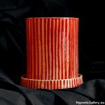 Ceramic flowerpot in cylinder shape. Ceramiczna doniczka w cylindrycznym kształcie.