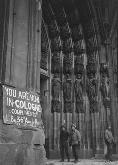 """You are now in Cologne. Compliments 1st Bn. 36 Armo Inf. Regt. Tex spearhead"" (Cologne, Germany, 1945)  Margaret Bourke-White—The LIFE Picture Collection/Getty Images"