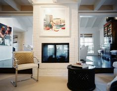 Double-Sided fireplace - maybe do a large painting above fireplace and remove the mantle.