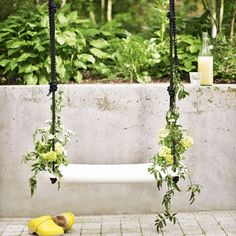 Poetic garden swing -   Create a magical feel in your garden with a simple swing. This gorgeous design features two integral plant pots so you can grow climbers up the ropes.   Swing from Places and Spaces