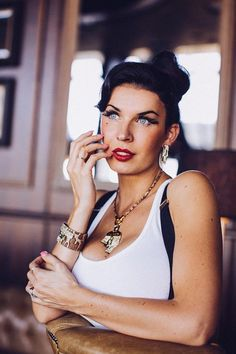 """What are the three most important fashion pieces that a pin up should have? """"Stay up stocking, lipstick and eyeliner... High heels, pencil skirt and a fixed hair-do."""" -Sini Tarkinnen"""