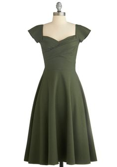 Pine All Mine Dress in Evergreen, #ModCloth shape and color. Usually this style is always done with some kind of floral print. What I love about this dress is that it's all one beautiful green color