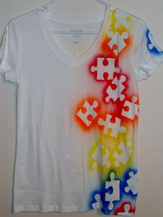 Lay down big puzzle pieces and spray paint over them. Wait until they dry to take the puzzle piece off. These would make beautiful autism awareness shirts. by pamela