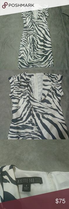 "Lafayette 148 New York Cassandra silk print dress Lafayette 148 New York egg shell white and navy blue zebra print, draped chest, sheath dress. Fully lined, bottom rear  slit opening. Zip up closure on the  back. 100% silk. Size 4. Pit to pit 17"", waist 15.5"", length 39"". Lafayette 148 New York Dresses"