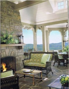 """A perfect perch to watch the sun set over these beautiful mountains.  Wicker furniture has been """"upholstered"""" to create a more finished, formal feeling.  Magazine:Veranda  www.mainlybaskets.com"""