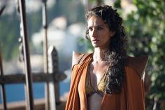 Ellaria Sand wearing a bikini-style top and pointy-shouldered cape.
