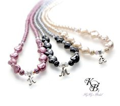 Choose your Swarovski pearl color for this beautiful bridesmaid necklace personalized with a sterling silver script initial charm.