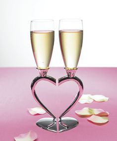 Silver Plated Interlocking Heart Stems with Glass Flutes. These are so pretty I am getting these for our toast.