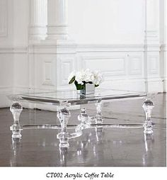 omg! I love this acrylic table.  It's like cinderella's shoe in your living room!