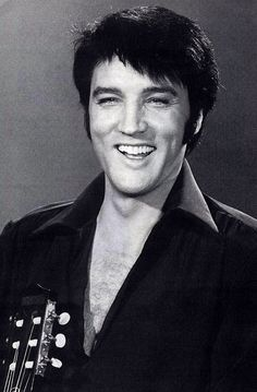 Elvis looks like he is really enjoying what he does. His motto was: Make someone happy.