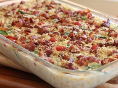 BLT Mac N Cheese: 32oz Velveeta, 1/4c butter, 4c milk, 16oz macaroni, 2c shredded sharp Cheddar, 2c cherry tomatoes, 9 oz bag fresh spinach, 1 lb crumbled crispy bacon, 1c plain or Italian panko...Melt cheese, butter  milk on stove or in microwave, cook  drain macaroni  put in 4qt baking dish. Pour melted cheese sauce over macaroni  mix well. Stir in cheese, tomatoes  spinach. Cover with foil; bake at 350 for 30 min, then sprinkle bacon  panko evenly over top. Bake uncovered 5 min longer.