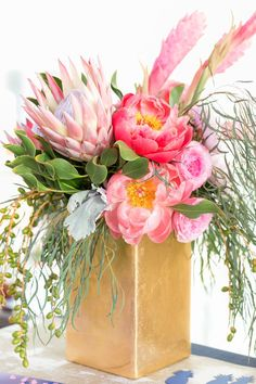 Paper Party 2015: Tropical Floral Arrangements with peonies, garden roses, ranunculus, king protea, and ginger flowers / flowers by Flower Muse / Floral design by Soirée Floral / Photo by Charlie-Juliet Photography