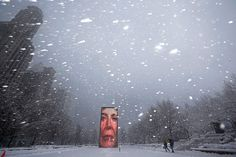 blizzard in chicago | he walks through millennium park in chicago jim young reuters