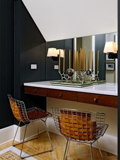 See this contemporary black bathroom with custom vanity chairs on HGTV.