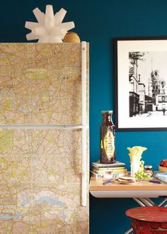I am going to decoupage my ugly beige fridge. What should I cover it with? I am thinking maps, because this one looks great!