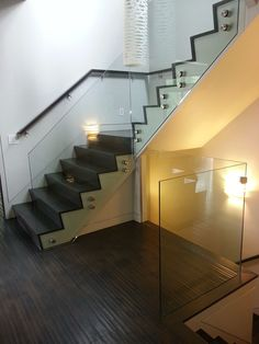 A glass staircase can quickly become a visual centerpiece in a home or a business. Sleek, modern and safe, our glass staircases dazzle the eye. Glass Stairs Design, Stair Railing Design, Staircase Railings, Modern Staircase, Stair Decor, Glass Railing, Staircase Ideas, Painted Staircases, Painted Stairs