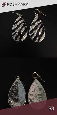 """Zebra and Rhinestone Teardrop Earrings Zebra and Rhinestone Teardrop earrings with faux shiny sliver finish. For pierced ears. About 2"""" long. No tags but never worn. none Jewelry Earrings"""
