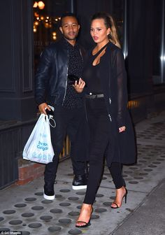 Date night: Chrissy Teigen looked slim and chic in a black ensemble while enjoying dinner out with husband John Legend on Friday in NYC