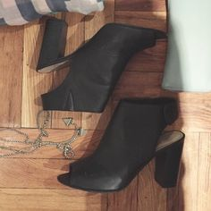 Open toe and heel booties with snap back Faux leather. Peep toe and open back that snaps together for comfortable wear. 4 inch stacked heel. Worn about 4 times Shoes Ankle Boots & Booties