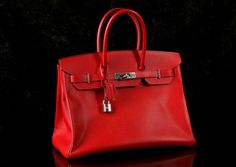 HERMES BIRKIN 35 IN ROUGE CASAQUE EPSOM LEATHER, date code for 2013, palladium hardware, 35cm wide, 25cm high, complete with padlock, keys and cloche, a rain jacket, dust bag, copy of receipt from Designer Exchange in Knightsbridge, 2015, and a Whispersales authentication certificate