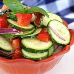 Enjoy this veggie salad while the cucumbers, tomatoes, and zucchini are ripe on the vines. A lemon-scented vinaigrette dressing, fresh basil, thyme and black olives add their flavor and color.