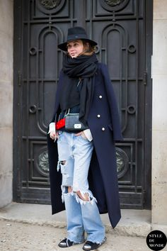 Haute Couture SS 2014 Street Style: Jill Bauwens - STYLE DU MONDE |  29 Jan '14 A woman wearing Celine Pre-Fall 2013 wool felt coat with pearl buttons, wide ripped jeans, Chanel boy bag, Maison Michel hat, a black scarf & metal cap toe shoes before Chanel SS14 Couture Show.