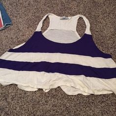 Striped Tank Top Cropped and striped purple and white tank top! Really cute and one of my favs  there is no size on the shirt, but it fits me and I'm a medium and fits my friend who's a small. Tops Tank Tops