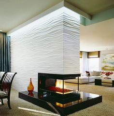 Stunning Wall Partition Designs With Pretentious Style: Brilliant Idea With Waving Carved Wall And Modern Fireplace Also Fur Rug With Stylish Sofa And Table