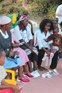 Wearing donated clogs at the Canini-Athi Lugnås orphanage in Kenya - Clogs for a Cause  - Troentorp Clogs