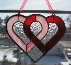 Entwined Hearts Stained Glass Suncatcher - Valentine's Day Decor - Wedding Gift - Anniversary Gift - Red and Pink by StainedGlassYourWay on Etsy https://www.etsy.com/listing/120967289/entwined-hearts-stained-glass-suncatcher