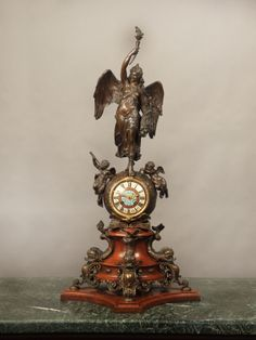 A Large and Important Late 19th Century Gilt and Patinated Bronze, French Champlevé Cloisonné Enamel and Wood Mantle Clock