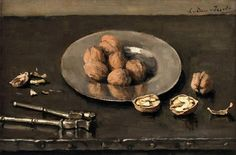 A still life with walnuts on a pewter plate  -  Lucie van Dam Van Isselt  Dutch, 1871–1949