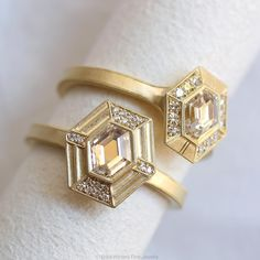 """#LoisHalo diamond ring by Erika Winters. """"The Lois is set with a stellar hexagonal cut diamond in 18k with my signature brushed finish and hand engraved detail"""" #alternativebridal #weddinginspo #weddinginspiration #weddingwednesday #weddings #alternativebride #jewelryaddict #engagementring"""