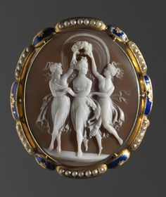 Cameo Brooch: The Three Graces Dancing Unknown artist After Antonio Canova Italian; Venetian, 1757-1822 Cameo Brooch: The Three Graces Dancing, after 1798 Shell, gold, pearl, and enamel Length: 5.9 cm (2 5/16 inches)