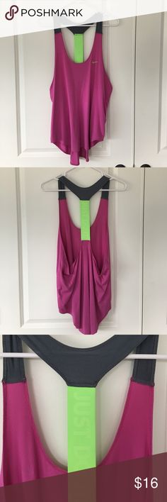 Nike Loose Fit Running Tank Nike loose fit, dry fit tank top for running. Some basic piling from wash. Longer fit. Nike Tops Tank Tops