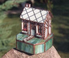 House with tree - 3-D lighted house with copper foil overlay tree and cobblestone walkway.