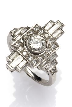 45ba9c994f39 An Art Deco platinum   diamond ring. The geometric front set with baguette  diamonds