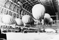 Royal Air Force Balloon Command, Inflated kite balloons of No. 1 Balloon Training Unit await their handlers, during the morning parade in No. 1 Airship Shed at Cardington, Bedfordshire, October Battle Of Britain, Ww2 Aircraft, Moto Guzzi, Royal Air Force, Isle Of Wight, World War, Wwii, Weapons, Balloons