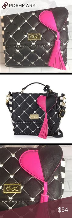 """NWT Betsey Johnson Purse This NWT Betsey Johnson Laurel Diamond Quilted Crossbody has diamond quilting with embroidered hearts, striped sides, and a tassel heart charm. There's a top handle and an adjustable, optional crossbody strap with a 23"""" drop. The exterior is faux leather, has gold-tone hardware, and has a flapped top with magnetic snap closure. The interior has a zippered pocket and is lined in striped fabric. It measures 8""""W x 8""""H x 3.5""""D. (I'm adding a few stock pictures so I don't…"""