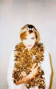 "We've heard of ""bathed in sequins"", but wrapped in tinsel? Yes, please!"