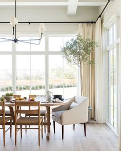 The Shade Store's Tailored Pleat Drapery in Luxe Linen Oyster feels right at home in this elegant dining room by Studio McGee.   #studiomcgee #diningroom #diningroomdecor #windowtreatments #drapery #interiordesign #design #homedecor