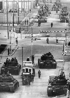 U.S. Army tanks, foreground, face off against Soviet tanks across the Berlin Wall at Checkpoint Charlie on the Friedrichstrasse, in a tense ..stand off Oct 27 1961.