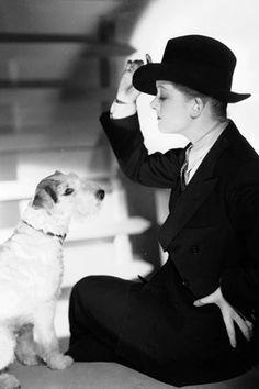 Skippy the famous wirehair fox terrier with actress Myrna Loy