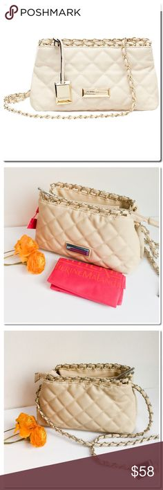 Catherine Malandrino Quilted Crossbody Details & Care A diamond-quilted finish and pull-through chain strap further the vintage sophistication of a compact crossbody bag. An optional luggage tag and logo plaque provide a polished finish. Top zip closure. Crossbody strap. Protective metal feet. Lined. 10.5 x5.5 x5 Polyurethane. By Catherine Catherine Malandrino; imported. Catherine Malandrino Bags Crossbody Bags