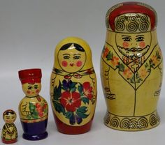 Vintage 1960s Set of 4 Russian Semenov Nesting Stacking Dolls Family - made in USSR, $50.00